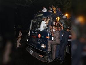 Rahul Gandhi being carried in a police bus from Parliament Street Police Station in New Delhi