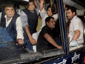Rahul Gandhi with party leaders Raj Babbar,Deepender Singh Hooda and Jyotiraditya Scindia being carried in a police bus