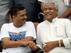 Delhi CM Arvind Kejrival shares a lighter moment with senior BJP leader Ram Lal