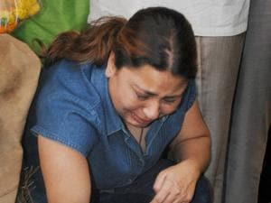 A woman breaks down while paying tributes to police horse Shaktiman in Dehradun