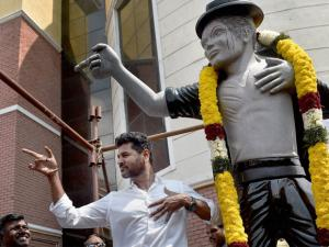 Actor-Director Prabhu Deva strikes a Michael Jackson pose after unveiling a statue of the pop icon at private university in Chennai