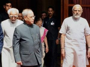 President Pranab Mukherjee with Vice President Hamid Ansari and Prime Minister Narendra Modi during the ceremonial departure of President to China