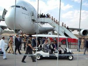 President Pranab Mukherjee and Civil Aviation Minister Ashok Gajapathi Raju move around in a battery operated vehicle at India Aviation Exhibition 2016 at Begumpet Airport in Hyderabad
