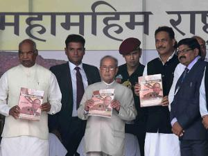 President Pranab Mukherjee with others releasing a book during visit to Vikramshila University Monuments and Museum in Bhagalpur district in Bihar