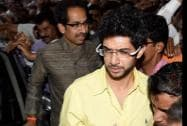 Shiv Sena president Uddhav Thackeray along with his son Aditya arrive for a press conference