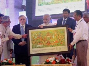 Prime Minister Narendra Modi receives memento at the inaugural function of Global Ayurveda Festival in Kozhikode