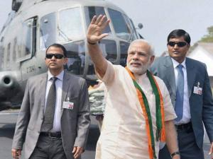 Prime Minister Narendra Modi waves to the crowd on his arrival in Kozhikode