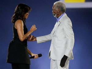 First lady Michelle Obama, left, greets actor Morgan Freeman before he was to speak during the opening ceremony for the Invictus Games