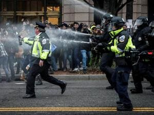 Police fire pepper spray on protestors during a demonstration after the inauguration of President Donald Trump in Washington