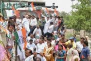Congress party workers stop a train