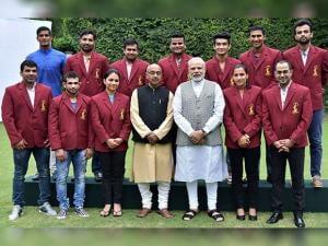 Prime Minister Narendra Modi and sports Minister Vijay Goel pose with Arjuna Awards winners