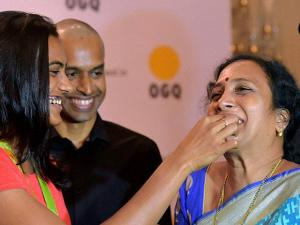 PV Sindhu along with mother  P Vijaya and coach Gopichand