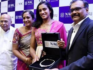 P V Sindhu being felicitated at an event