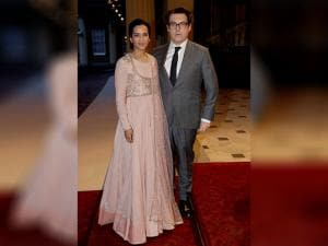 Indian sitar player Anoushka Shankar and her husband British director Joe Wright pose for photographs