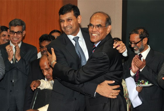 Reserve Bank of India's (RBI) newly appointed governor Raghuram Rajan signs official papers and  outgoing governor D. Subbarao  at handover ceremony at the RBI headquarters in Mumbai on 4th September, 2013.---PHOTO-SURYAKANT NIWATE