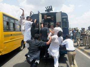 Rahul Gandhi is taken away in a vehicle on his way to Mandsaur