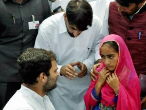 Congress Vice President Rahul Gandhi interacts with a girl