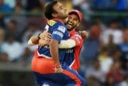 Delhi Daredevils' bowler Amit Mishra celebrates with captain J P Duminy