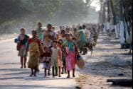 Bodo villagers moving towards a safer place