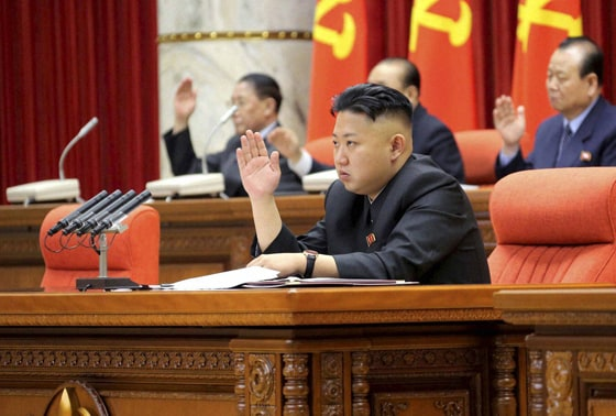 North Korean leader Kim Jong Un with other officials to adopt a statement during a plenary meeting of the central committee of the ruling Workers' Party in Pyongyang