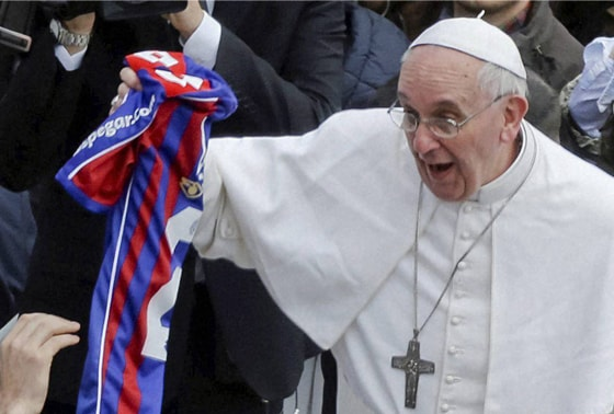 Pope Francis holds a San Lorenzo's jersey, the Buenos Aires soccer team, handed to him by a faithful at the end of the Easter mass in St. Peter's Square at the Vatican, Sunday, March 31, 2013. Pope Francis made an Easter Sunday peace plea, saying conflicts have lasted too long in Syria, and between Israelis and Palestinians. AP/PTI