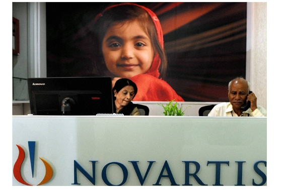Receptionists at work at Novartis India in Mumbai on Monday. PTI Photo