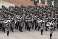 Indian paramilitary soldiers march.