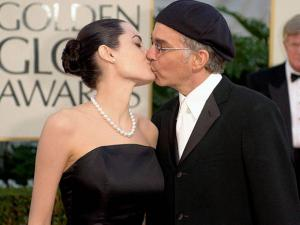 Billy Bob Thornton kisses his wife, Angelina Jolie after arriving for the 59th Annual Golden Globe Awards
