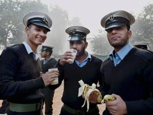 Indian Coast Guard personnel take refereshments during a rehearsal ahead of the Republic Day parade
