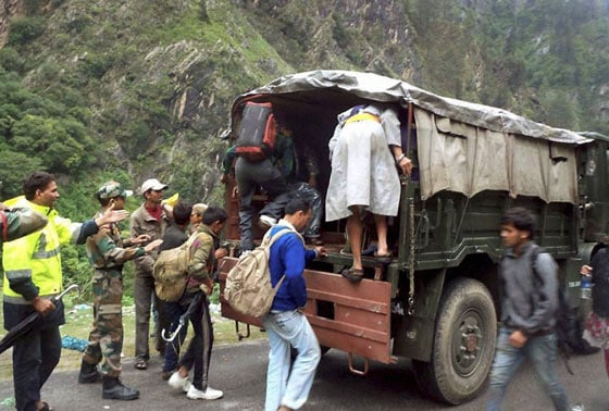 Army personnel shift stranded pilgrims to a safe place in flood-hit Govind Ghat in Chamoli, Uttarakhand on Tuesday. Floods triggered by torrential rains have stranded many people in the state.