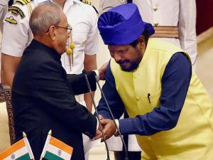 Pranab Mukherjee shakes hands with Ramdas Athawale after he was sworn-in as Minister of State
