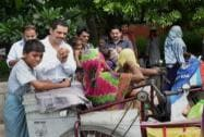 Robert Vadra distributes biscuits among the differently-abled people