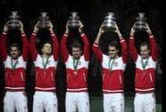 Hold the trophy after winning the Davis Cup final between France and Switzerland