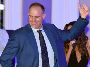 Australian cricketer Matthew Hayden does dance moves during a performance at CEAT Cricket Rating awards night in Mumbai