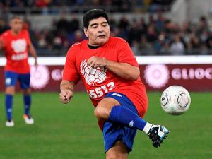 Diego Maradona warms up prior to the 'United for Peace', charity soccer match