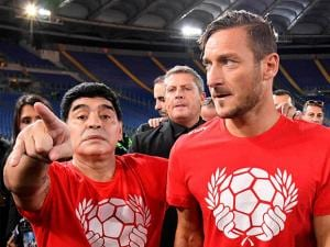 Soccer legend Diego Maradona with Italian captain of AS Roma, Francesco Totti