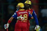 Royal Challengers Bangalore's Chris Gayle being greeted by captain Virat Kohli after completing half century against Delhi Daredevils