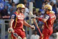 Royal Challengers Bangalore batsman AB De Villiers being congratulated by captain Virat Kohli