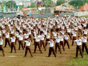 RSS volunteers wearing trousers, take part in a rehearsal of Vijayadashmi function
