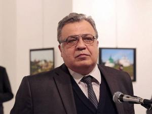 The Russian Ambassador to Turkey Andrei Karlov speaks a gallery in Ankara