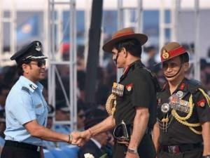 Army Chief Gen Dalbir Singh Suhag shakes hands with Honorary Group Captain Sachin Tendulkar
