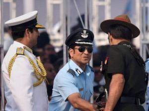 Army Chief Gen Dalbir Singh Suhag shakes hands with Honorary Group Captain Sachin Tendulkar as Navy Chief RK Dhowan