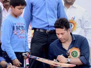 Sachin Tendulkar signing an autograph