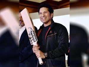 Sachin Tendulkar poses with bat during the launch of the equipment range Sachin by Spartan