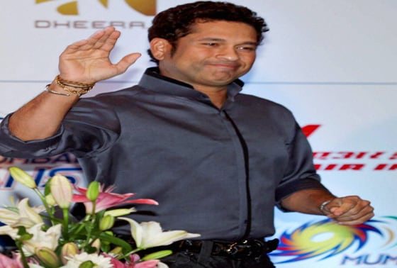 Sachin Tendulkar gestures during his 40th birthday celebration in Kolkata