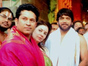 Cricket legend Sachin Tendulkar accompanied by wife Anjali and actor Akkineni Nagarjuna coming out of Lord Venkateswara temple at Tirumala in Tirupati