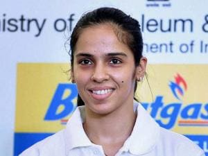 Shuttler Saina Nehwal holding a LPG subsidy GiveItUp brochure during an event
