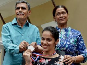 Saina Nehwal poses with her father Harvir Singh and Mother Usha Rani