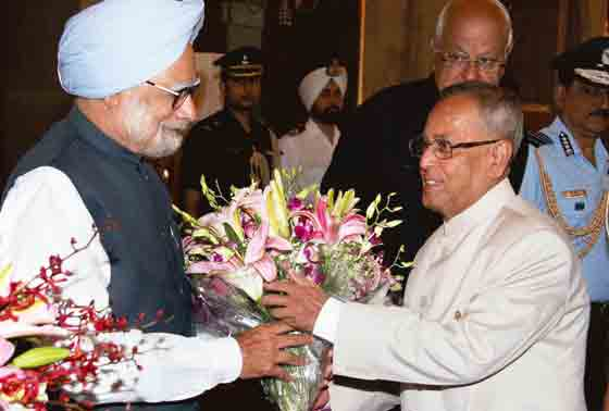 President Pranab Mukherjee is greeted by the Prime Minister