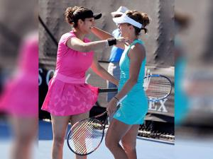 India's Sania Mirza and partner Barbora Strycova of the Czech Republic celebrate their win
